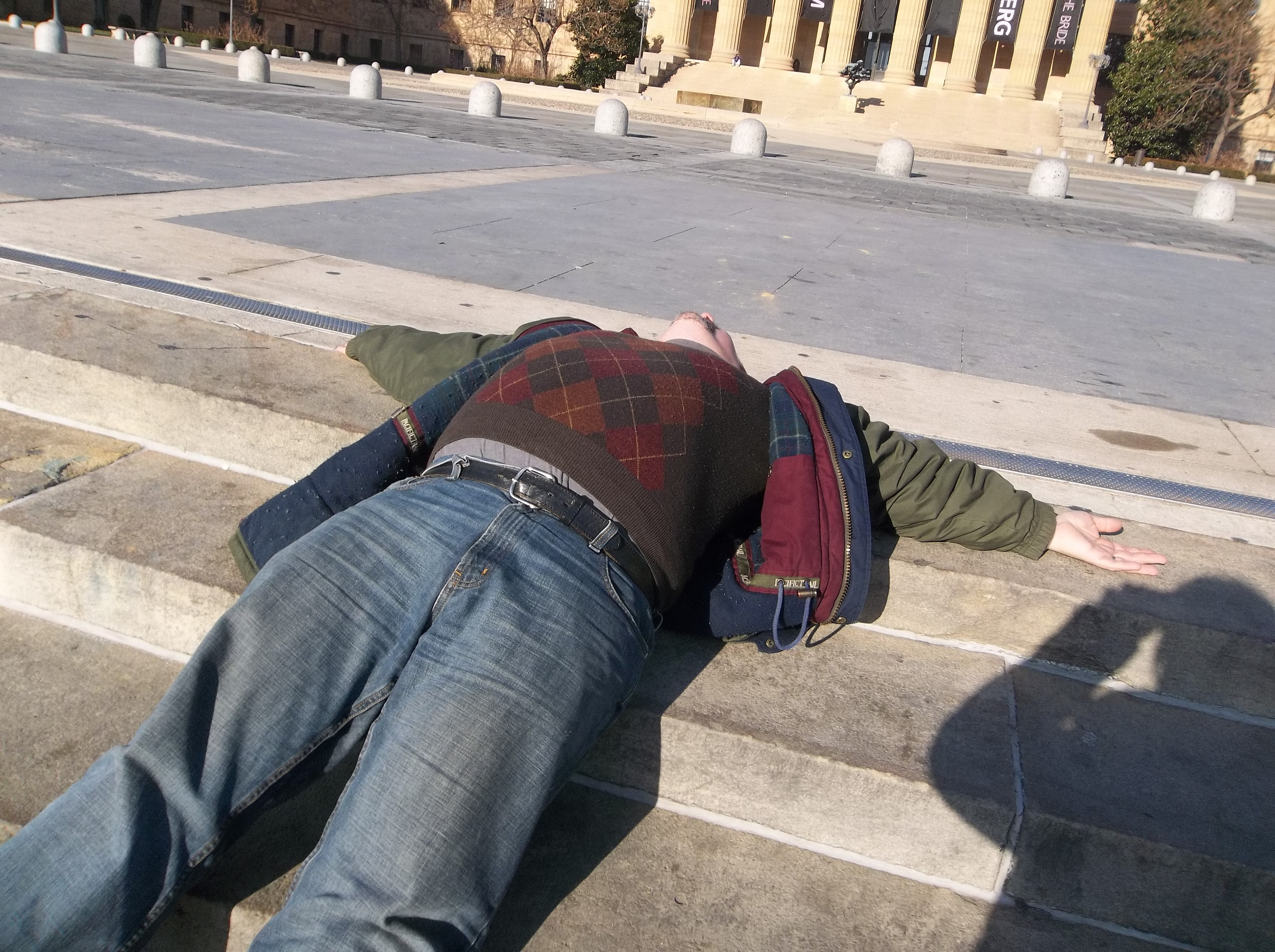 """Me reclining after walking up the """"Rocky"""" stairs at the Philadelphia Art Museum."""