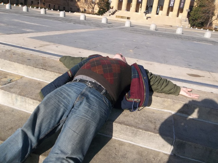 "Me reclining after walking up the ""Rocky"" stairs at the Philadelphia Art Museum."