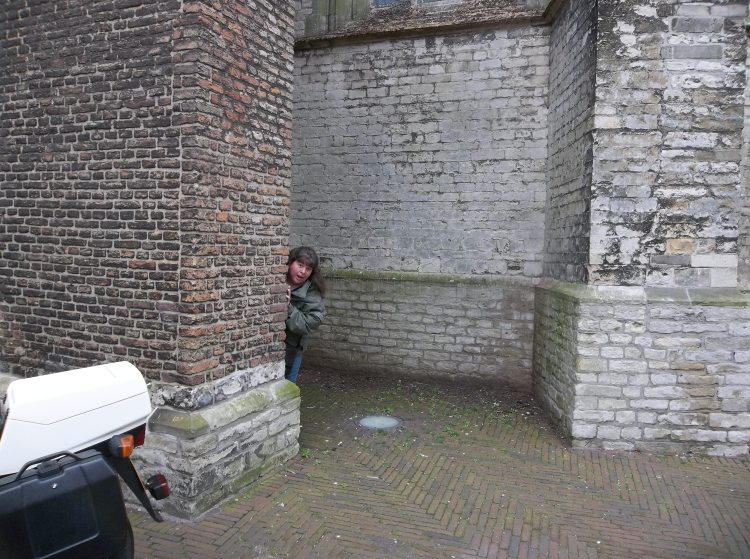 My sister tries to sneak up on me at the Oude Kerk. She is really bad at it.