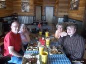 Joe's mom and grandparents and Joe at the BBQ