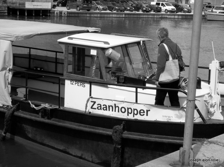 The Zaanhopper is a little touring boat that takes passengers from Wormerveer to Zaandam down the Zaan river.