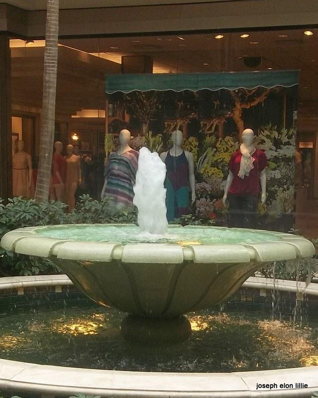 Manequins Enjoying a Fountain