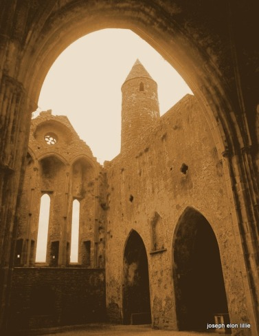 A steeple tower framed in the ruins of the Rock of Cashel